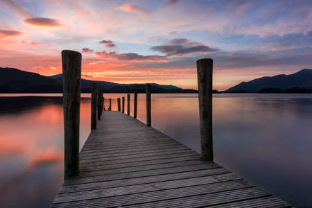 Ashness Jetty with a stunning spring sunset over Derwentwater in the Lake District, UK.