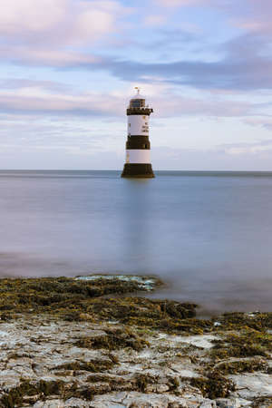 Penmon Point Lighthouse on the Isle of Anglesey in North Wales, UK.