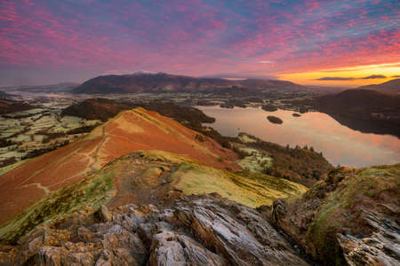 Vibrant Mountain Sunrise Taken From High Up Catbells Summit Looking Over Calm Derwentwater Lake. Lake District National Park, UK.