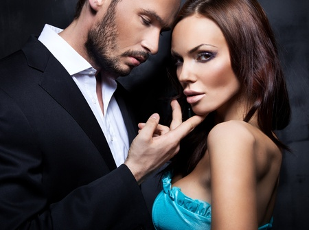 Sexy couple, beautiful brunette woman and handsome man Stock Photo - 9451681