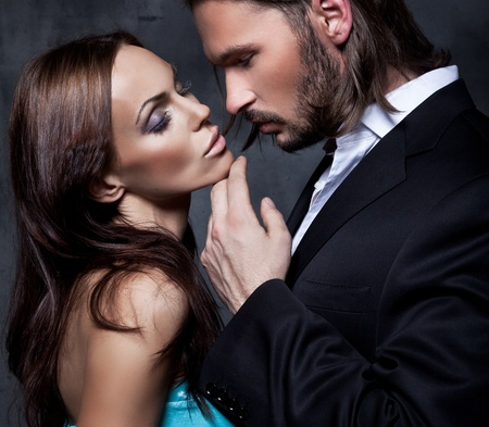 Portrait of romantic couple touching and kissing each other