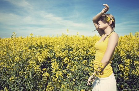 weekend break: Young business woman relaxing on golden meadow Stock Photo