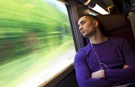 blur subway: Portrait of a young handsome man in the train Stock Photo