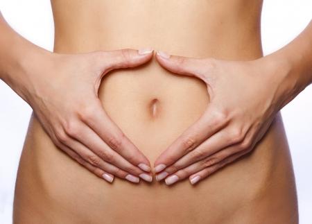 flat stomach: Bella corpo femminile isolato su bianco. Archivio Fotografico
