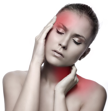hand on forehead: woman with headache on white background