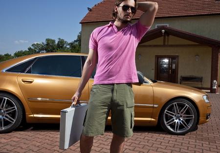 business man standing near the car