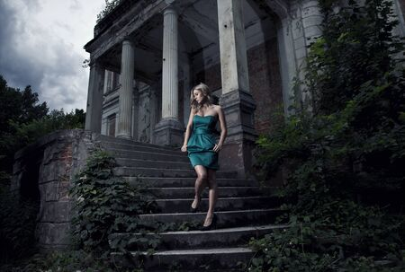 goes: beautiful blonde woman goes down the stairs  Stock Photo