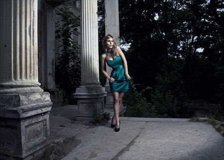 beautiful blonde woman posing in green dress  Stock Photo - 10019595