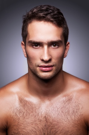 model nice: portrait of handsome guy on gray