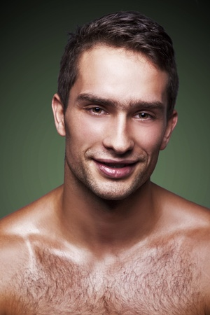 chest hair: portrait of handsome man on green background  Stock Photo