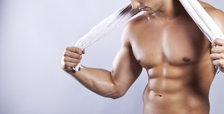 tummy: handsome muscular man with towel  Stock Photo