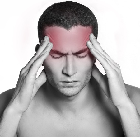 hand on forehead: Handsome man having a migraine isolated on white