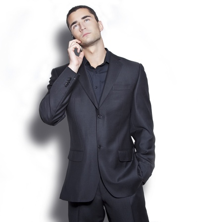 Elegant young businessman talking over cellphone photo