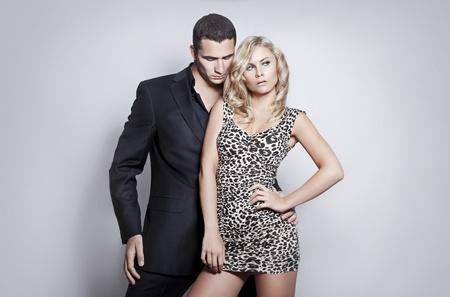 Portrait of romantic couple on gray background