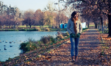 outdoor walking: Young slim woman walking in the park Stock Photo