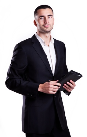 Elegant young businessman with notebook isolated on white  Stock Photo