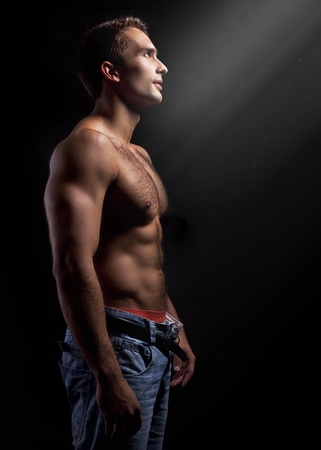 art photo of a young muscular man  photo