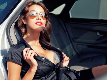 girl boobs: sexy business woman in the car