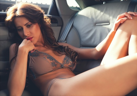 sexy business woman: fashionable young beautiful woman in the car  Stock Photo