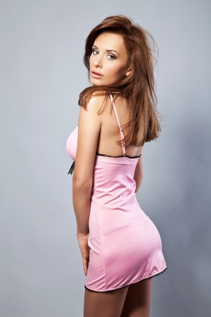 beautiful brunette woman in pink nightclothes  photo