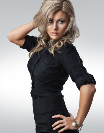 fashion style photo of young woman in studio  photo