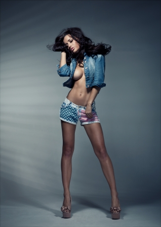 Sexy brunette woman in studio