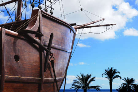 galley: Anchor boat with Palm trees in the front Stock Photo