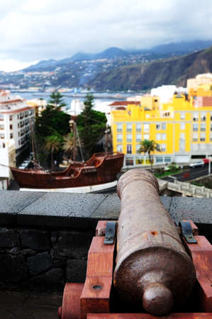 gunnery: Cannon pointing to boat in the middle of the city  Stock Photo