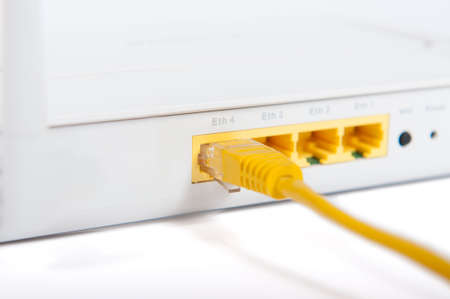 RJ45 connector plugged into a DSL router Stock Photo