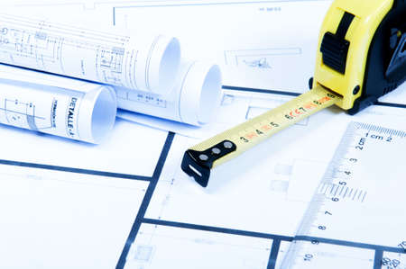 planos ingenier�a: Engineering drawings with a ruler and a meter