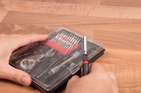 precision: Precision Tool Kit on a wooden desk Stock Photo