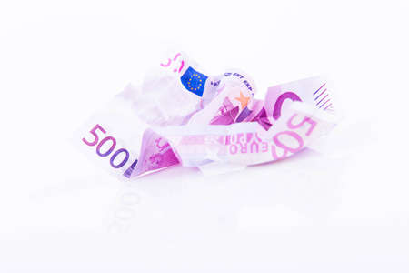 EUR 500 note crumpled on white background
