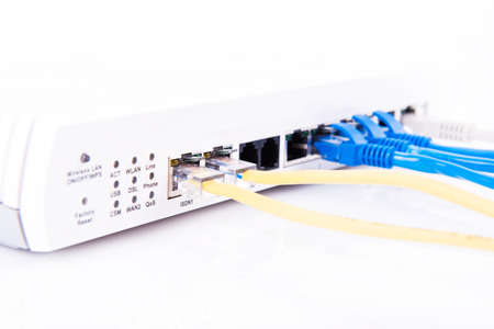 hub computer: RJ45 connected to a router on white background