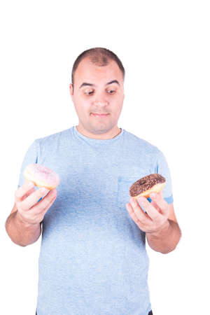 what to eat: Man with two donuts in hand thinking about what to eat on white background