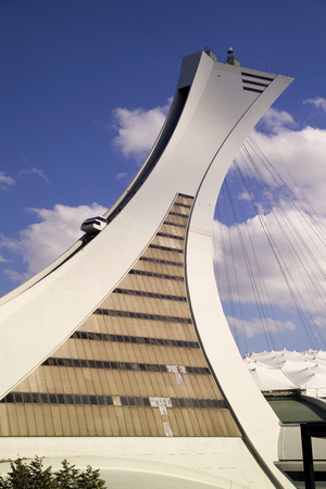 The tower is the tallest inclined tower in the world. Olympic Tower stands 175 meters tall and at a 45-degree angle. With the monorail climbing the tower.