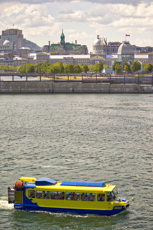 Amphibious vehicule carrying tourists around the Old Port in Montreal, Canada.