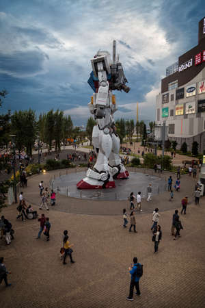 Tokyo, Japan; October 29 2014: Gundam, the giant Tokyo robot surrounded by many people in the Diver City shopping center in Odaiba, Tokyo
