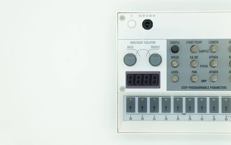 White analog synthesizer sampler with knobs and keys. Audio equipment for musical production. Drum machine. Isolated on white background. Music concept. Stok Fotoğraf