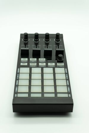 midi controller for disc jockey,sound producer & composer.Create electronic musical tracks with modern digital beat machine with knobs and pads isolated on white background, music concept Foto de archivo