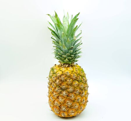 Isolated pineapple on a white background in the center of the image. Tropical fruit. Healthy food concept.