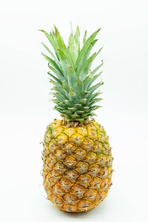 Close-up view of Pineapple isolated on a white background in the center of the image. Tropical fruit. Healthy food concept.