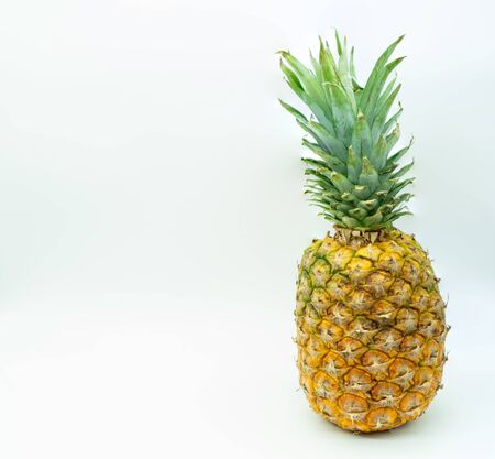Isolated pineapple on a white background on the right with space on the left for text. Tropical fruit. Healthy food concept. Reklamní fotografie - 140373909