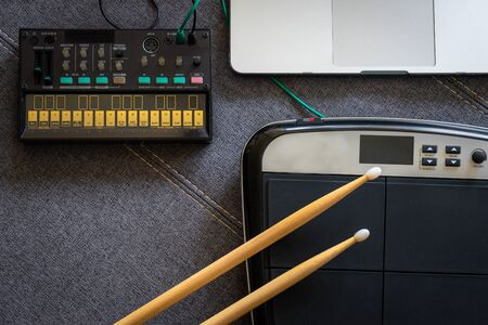 Top view of drum pads with drumsticks, fm synthesizer and a laptop. Music concept. Reklamní fotografie
