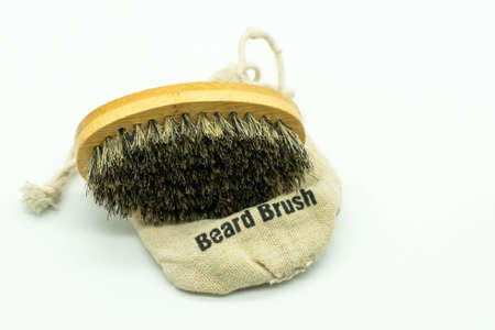 Bamboo beard brush with natural bristles on its case Care for the beard. Concept facial care for men.