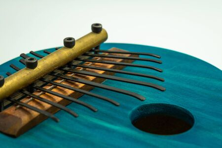 Detailed view of blue African kalimba on a white background. Traditional African music concept Reklamní fotografie