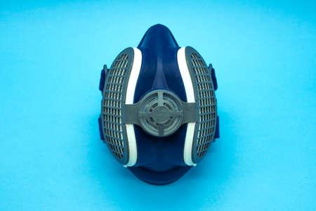 Close-up of isolated coronavirus mask on blue background. Concept virus. Covid-19.
