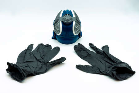 Horizontal view of black nitrite gloves and coronavirus mask, isolated on a white background. Virus concept. Covid-19. Imagens