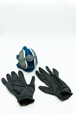 Vertical view of black nitrite gloves and coronavirus mask isolated on a white background Pandemic concept. Covid-19. Reklamní fotografie