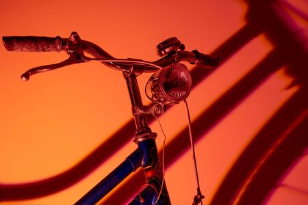 Close-up view of old bike with isolated front light on colored background. Old bike concept.