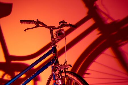 Antique bicycle with isolated front light on colored background. Old bike concept.